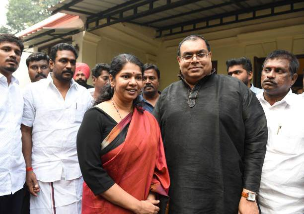 DMK MP Kanimozhi with her husband G Aravindan and other political memners at her residence